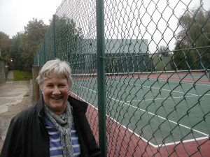 Cllr Jane Pickard looking at the existing outdoor tennis courts
