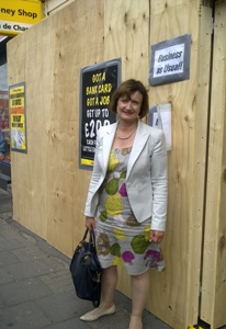 Tessa Jowell outside damaged  Money Shop
