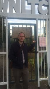 Dan outside locked club gates